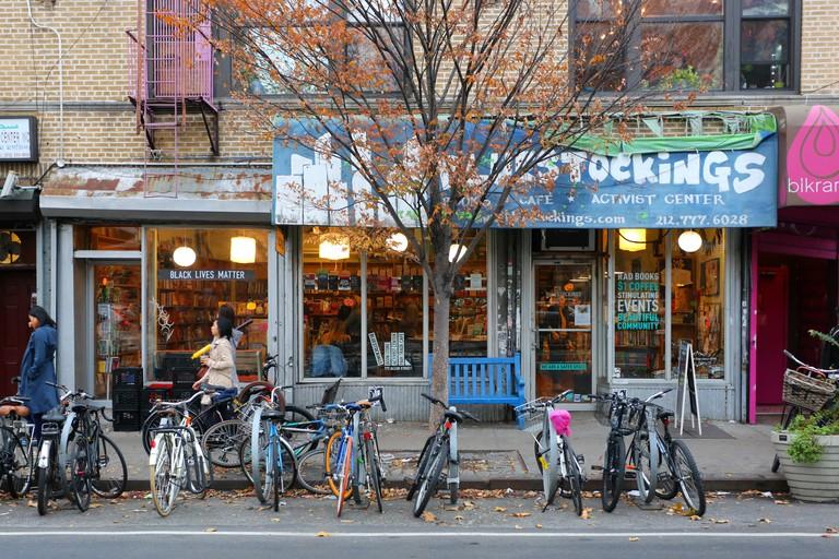 [historical storefront] Bluestockings Bookstore, 172 Allen St, New York, NY.