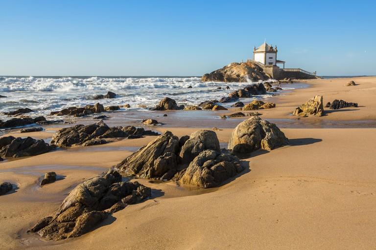 Miramar Beach (Praia de Miramar) and chapel Senhor da Pedra, near Porto, Portugal.