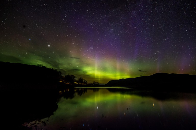 The Northern Lights (Aurora Borealis) reflected in Loch Loyal, Scotland