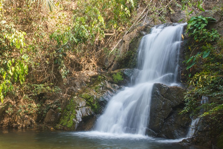J17503 Thor Thip waterfall in thai national park.waterfall in the deep forest on mountain