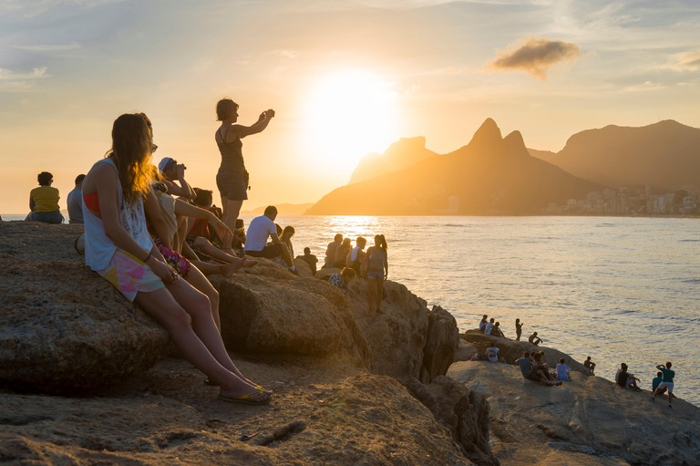 RIO DE JANEIRO - People on the rocks at Arpoador jostle for position to view the sunset at Two Brothers Mountain: