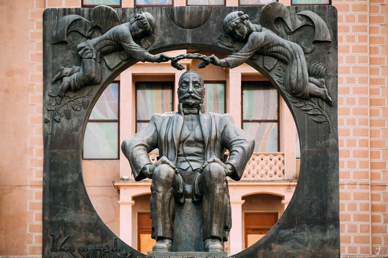 Batumi, Adjara, Georgia - May 27, 2016: Statue Monument To Ilia Chavchavadze On Background Of Batumi State Drama Theatre Named After I. Chavchavadze.
