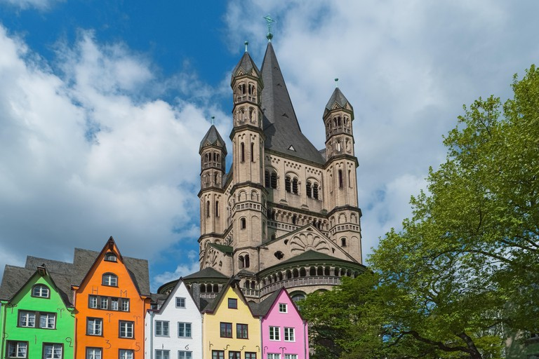 J3WMD7 Old houses, St. Martin Church, Cologne, Germany. Facade of colorful buildings in Cologne old town on Rhine river embankment. Beautiful european archit