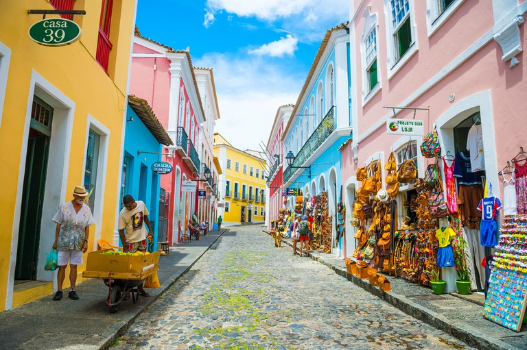 SALVADOR, BRAZIL - MARCH 9, 2017: Souvenir shops selling bags and local handicrafts line the traditional cobblestone streets of historic Pelourinho.