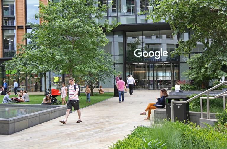 The entrance to Google's new UK headquarters building in St Pancras Square, London. Shows Google sign above door.