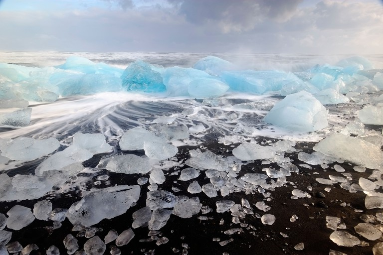 IceBergs and waves on Jokulsarlon Beach, Polar region, South Iceland