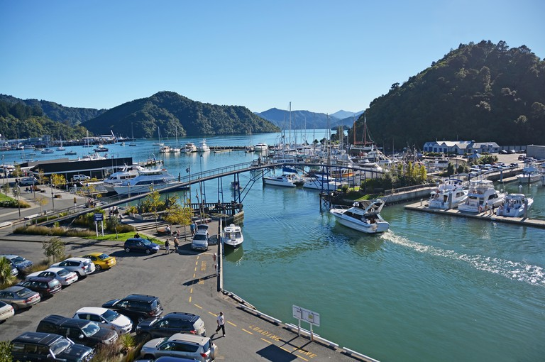 Picton, New Zealand - April 20, 2014: Picton boat & yacht marina and tourists in the Marlborough Sounds on an autumn morning.