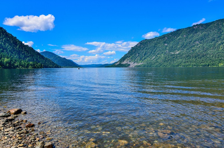 Transparent cleanest water of Teletskoye or Golden lake. Altai mountains summer landscape, Russia