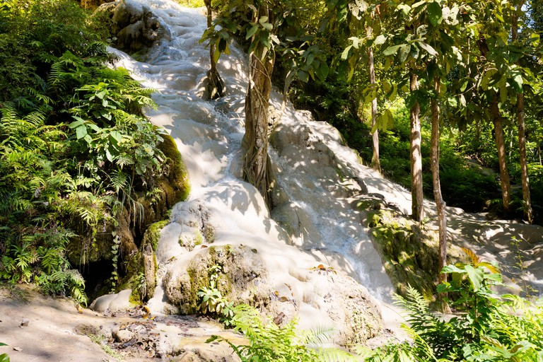 Paradise touristic Sticky Waterfall close to Chiang Mai in north Thailand. Beautiful asian nature during honeymoon.