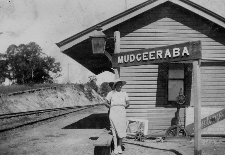 1 114756 Woman standing on the platform at the Mudgeeraba Station, Queensland, ca. 1938