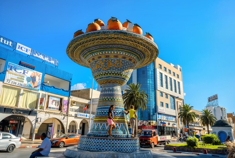 Cityscape with ceramic sculpture on road in city centre. Nabeul, Tunisia, North Africa
