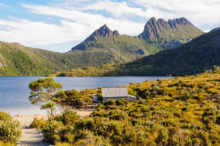 Historic Dove Lake boatshed beneath the towering spires of Cradle Mountain - Tasmania, Australia