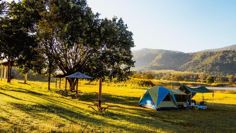 Tourist tent camping in mountains near lake, Khao Yai National park, Thailand