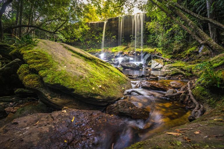 The landscape photo, beautiful rainforest waterfall in deep forest at Phu Kradueng National Park
