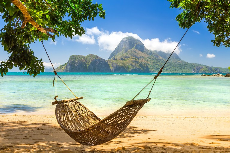 Traditional hammock in the shade on a tropical island