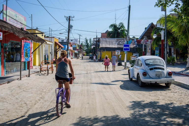 Tourists in a street of Isla Holbox, Quintana Roo (Mexico).