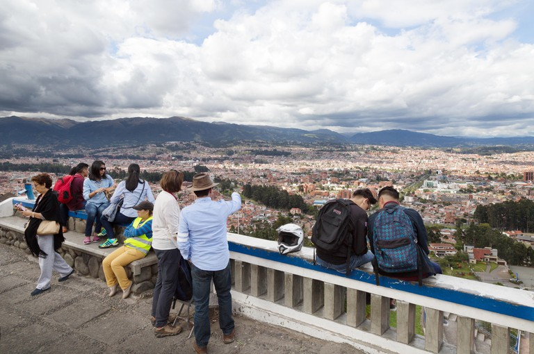 Cuenca Ecuador tourism; a tourist looking out over the city of Cuenca from Turi, Cuenca, Ecuador South America