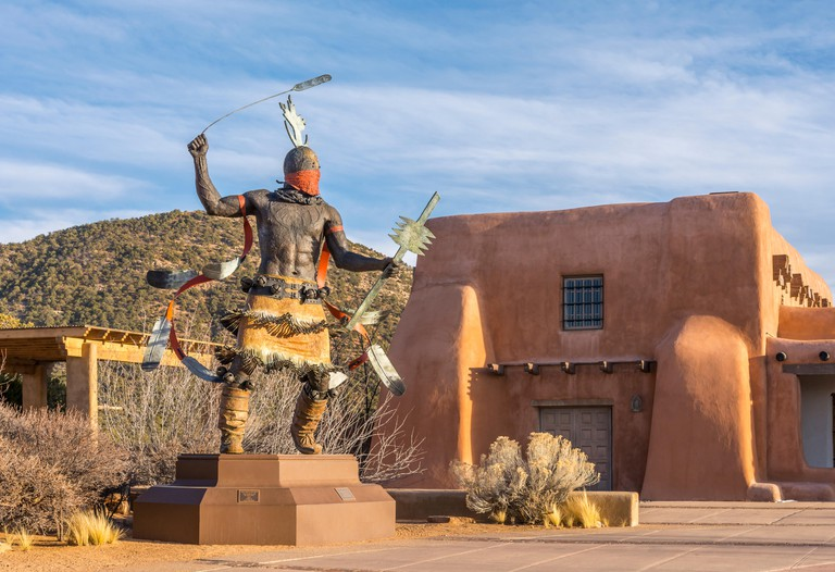 Museum of Indian Arts and Culture, Apache Mountain Spirit Dancer bronze sculpture by Goseyun and Anthropology Lab in Santa Fe, New Mexico USA.