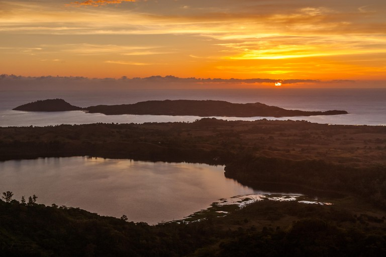 The sacred lake and the sea, view of Mont Passot, the highest point on Nosy Be island, northern Madagascar