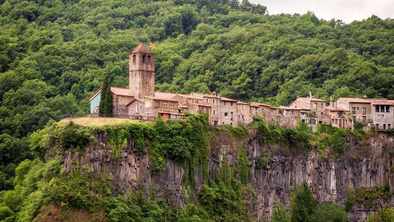 Medieval village Castellfollit De La Roca on the edge of a cliff. Catalonia, Spain.