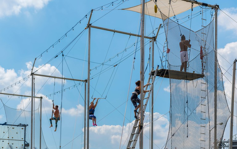 SEPTEMBER 2017- Washington DC: The New York School of Trapeze teaches students to fly through the air for a trendy new kind of adventure exercise