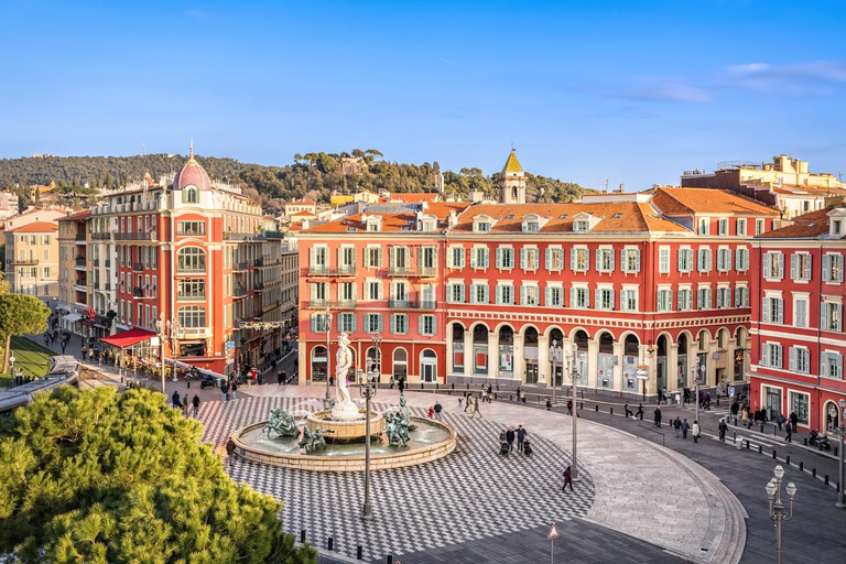 Aerial view of Place Massena square with red buildings and fountain in Nice, France - MA2N88