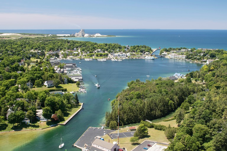 Aerial view of the Pine River leading to Round Lake with Charlevoix and Lake Michigan in the background, looking west.
