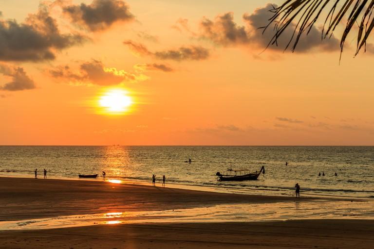 People silhouetted on the beach at sunset, Kamala, Phuket, Thailand