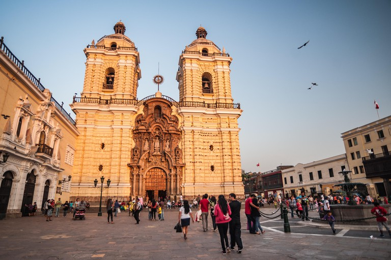 Lima, Peru - April 20, 2014: Ornate cathedral, Saint Francis Monastery (Basilica y Convento de San Francisco), illuminated by rays of summer sunset.