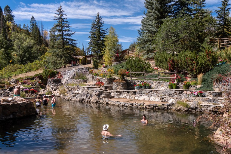 Bathers soak in the warm water, Strawberry Park Hot Springs, Steamboat Springs, Colorado.