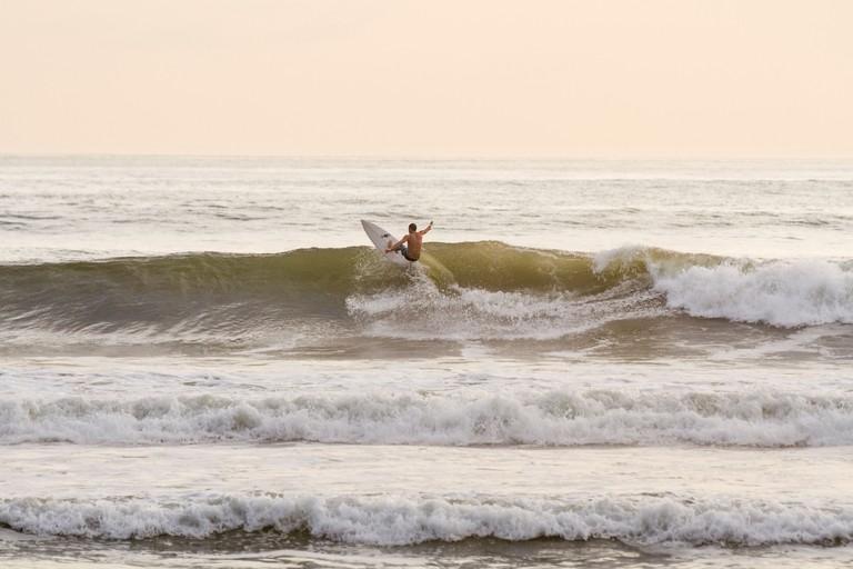 Surfing at Playa Santa Teresa, Puntarenas Province Costa Rica.