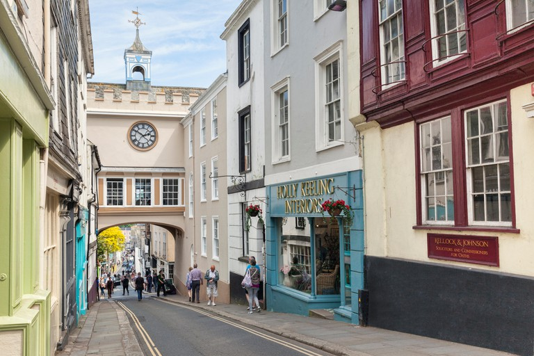 25 May 2018: Totnes, Devon, UK - Shoppers and tourists in the High Street.
