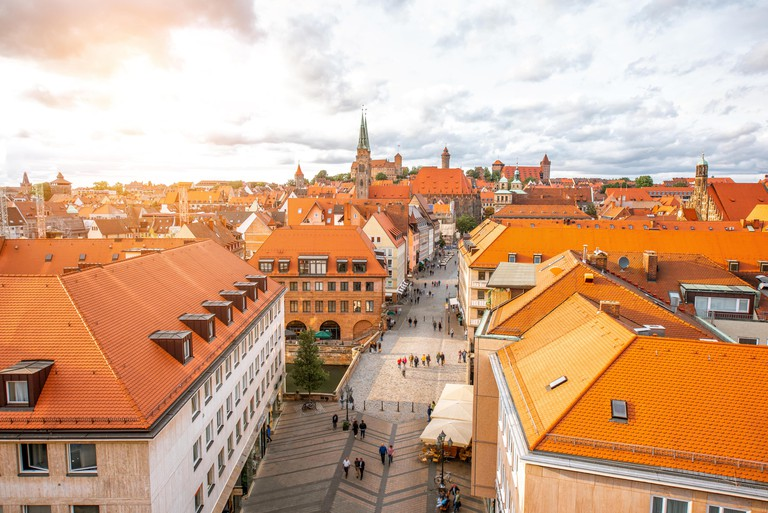 Top cityscape view on the old town with castle hill and cathedral in Nurnberg during the sunset, Germany