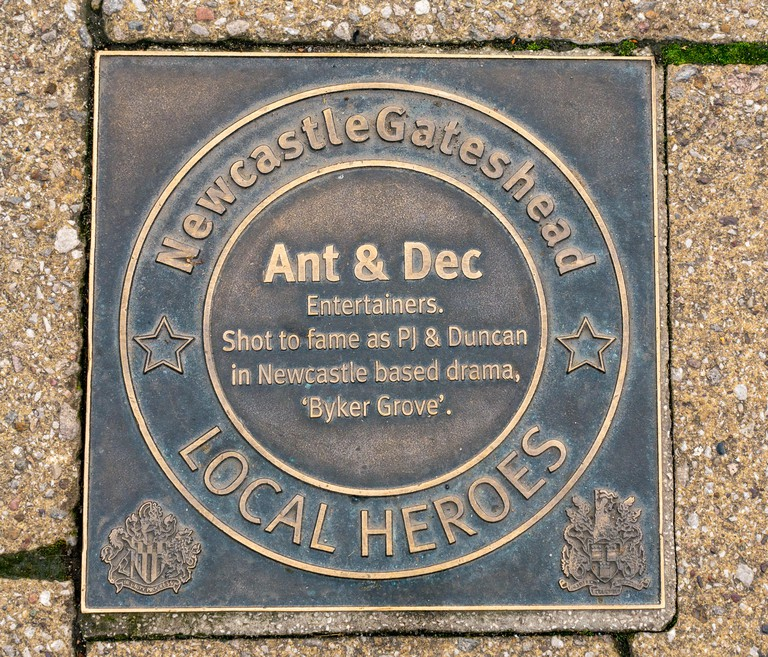 Bronze plaque honouring Newcastle and Gateshead inspiring people of past 60 years, Ant & Dec, Quayside. Newcastle Upon Tyne, England, UK