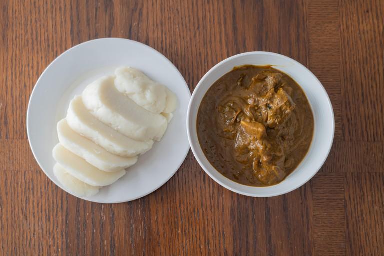 Nigerian pounded yam sliced served with banga Soup