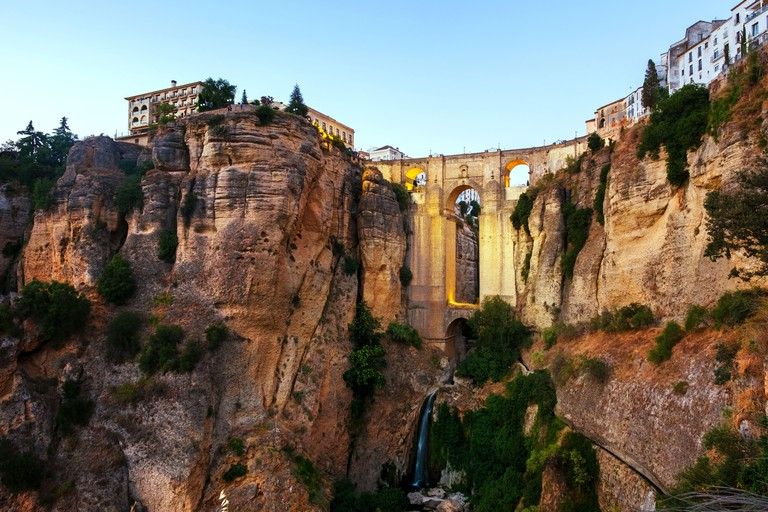Ronda, Spain. Evening view of New Bridge over Guadalevin River in Ronda, Andalusia, Spain with clear blue sky in summer