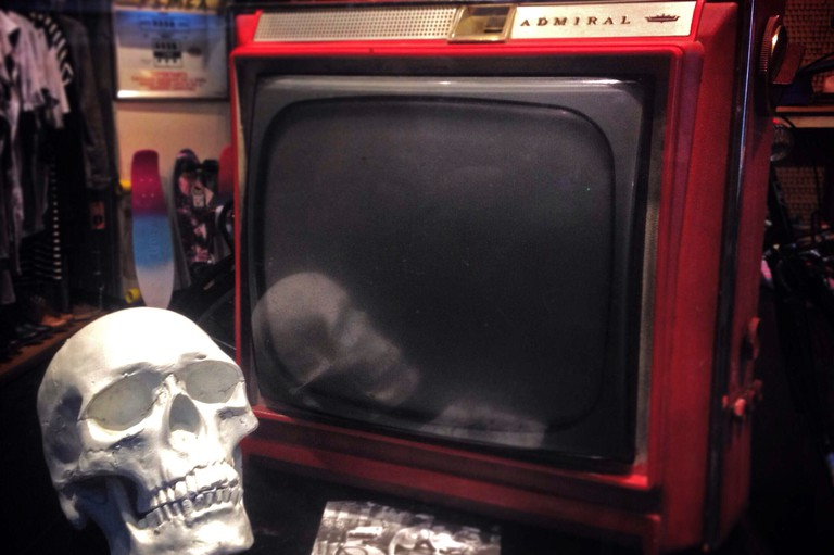 A skull and an old television decorate 180 shop in Colonia Roma, Mexico City, Mexico