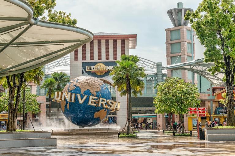 Crowds in front of Universal Studios Singapore at Resorts World Sentosa on Sentosa Island, Singapore