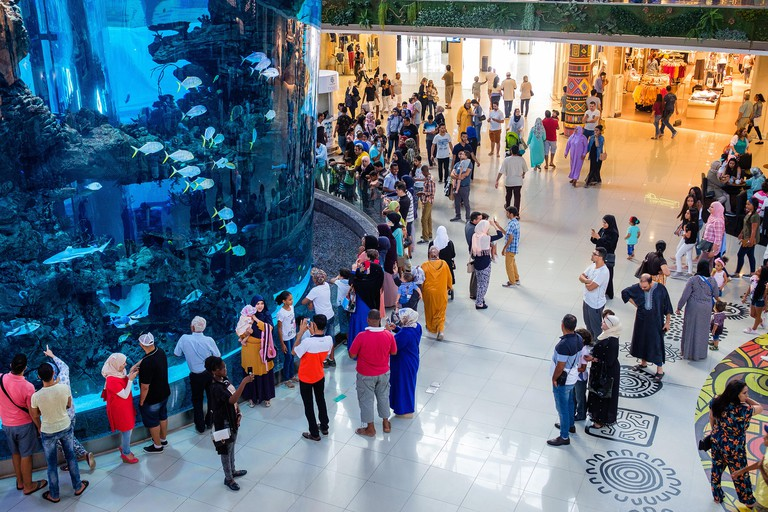 Morocco, Casablanca. Moroccan families in the Morocco Mall inaugurated in 2011. The second largest shopping centre in Africa, known for its numerous s