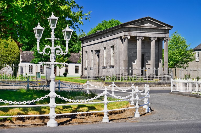 Ireland, County Offaly, Birr which is a town renowned for its Georgian architecture, John?s Mall, Johns Hall and a streetlamp with the area known as The Chains in the foreground due to the sturdy chain railings enclosing the central part of the Mall.