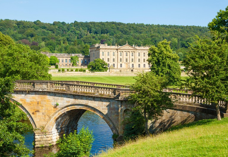 Chatsworth House park with an entrance bridge over the river Derwent parkland and woods Derbyshire England UK GB,  Europe