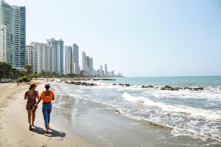Colombia, Cartagena, Bocagrande, Caribbean Sea public beach beachcombers