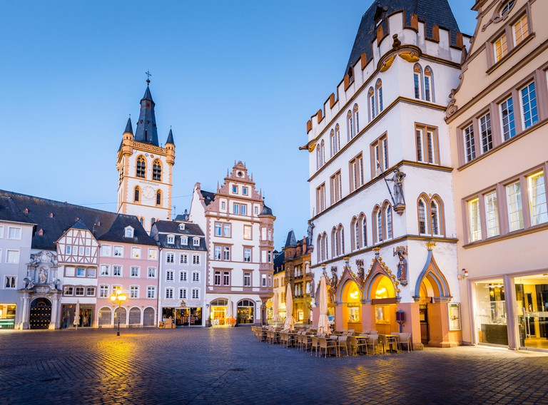 TRIER, GERMANY - MARCH 28, 2017: historic city center of Trier with famous Hauptmarkt market square and St. Gangolf church in beautiful post sunset tw