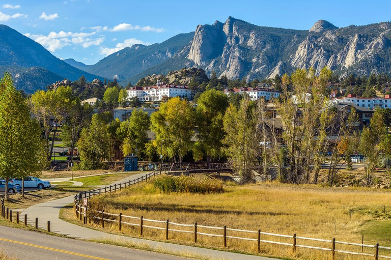 Estes Park - An autumn afternoon at Downtown Estes Park, with The Stanley Hotel and Rocky Mountains in background. Colorado, USA.