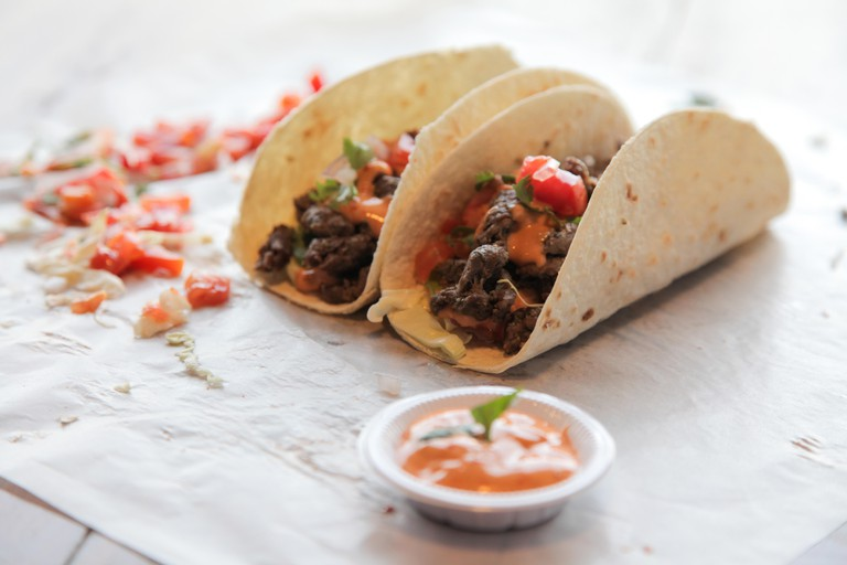Mexican steak beef tacos with dip condiments