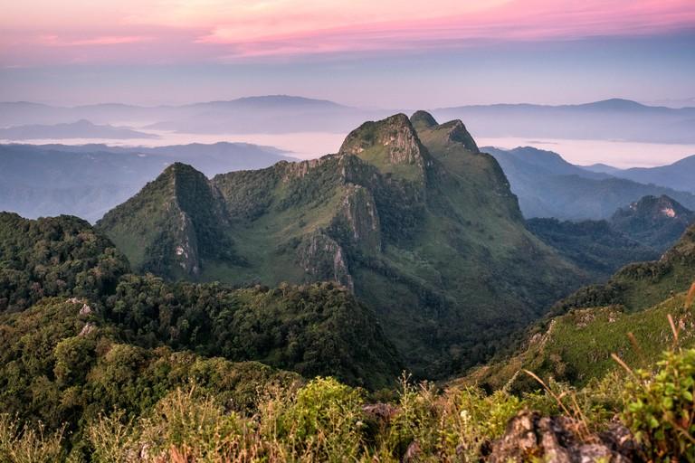 Peak mountain range at sunset in wildlife sanctuary. Doi Luang Chiang Dao