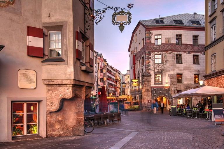 Evening scene in central Innsbruck, Austria. The scene is captured along the famous Herzog-Friedrich featuring some of the historical houses linining