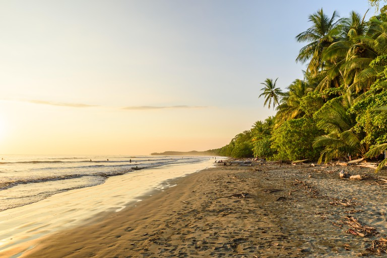 Sunset at paradise beach in Uvita, Costa Rica - beautiful beaches and tropical forest at pacific coast of Costa Rica - travel destination in central a