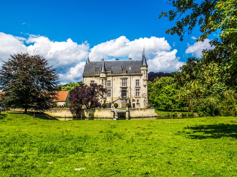 The building of Schaloen Castle in Oud-Valkenburg, Province of Limburg, The Netherlands against a beautiful July cloudy sky