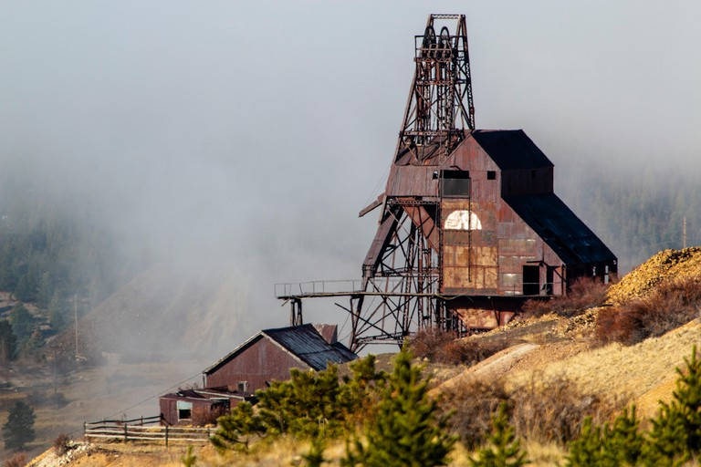 Mines and trees create ghostly figures in abandoned mine country near Cripple Creek Colorado